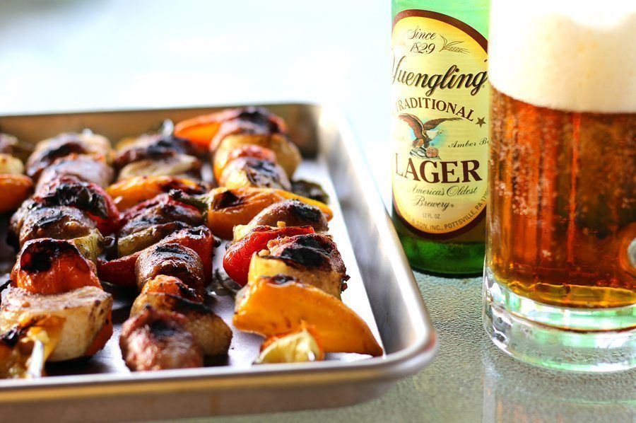 Bold beer brats cooked on the grill are a tasty side dish to enjoy this summer