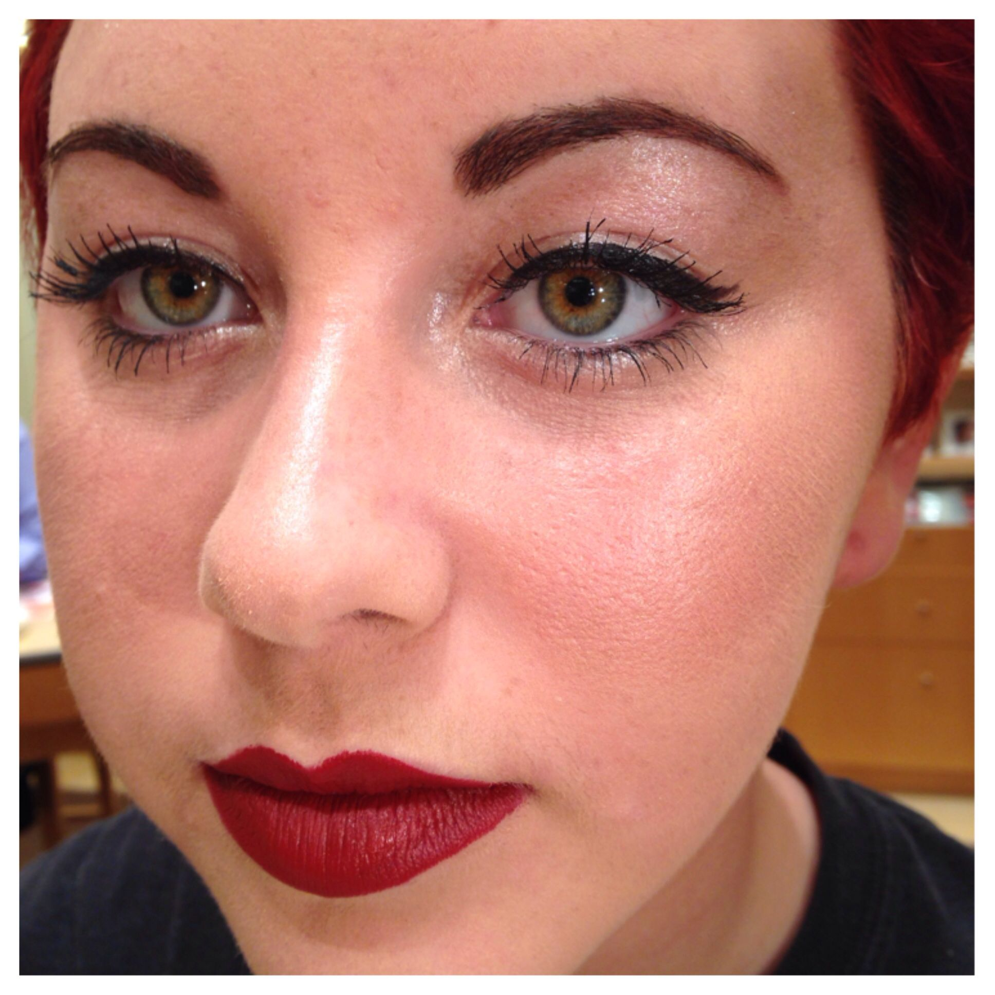 Merle Norman glossy bare eye and deep red lips and glowy