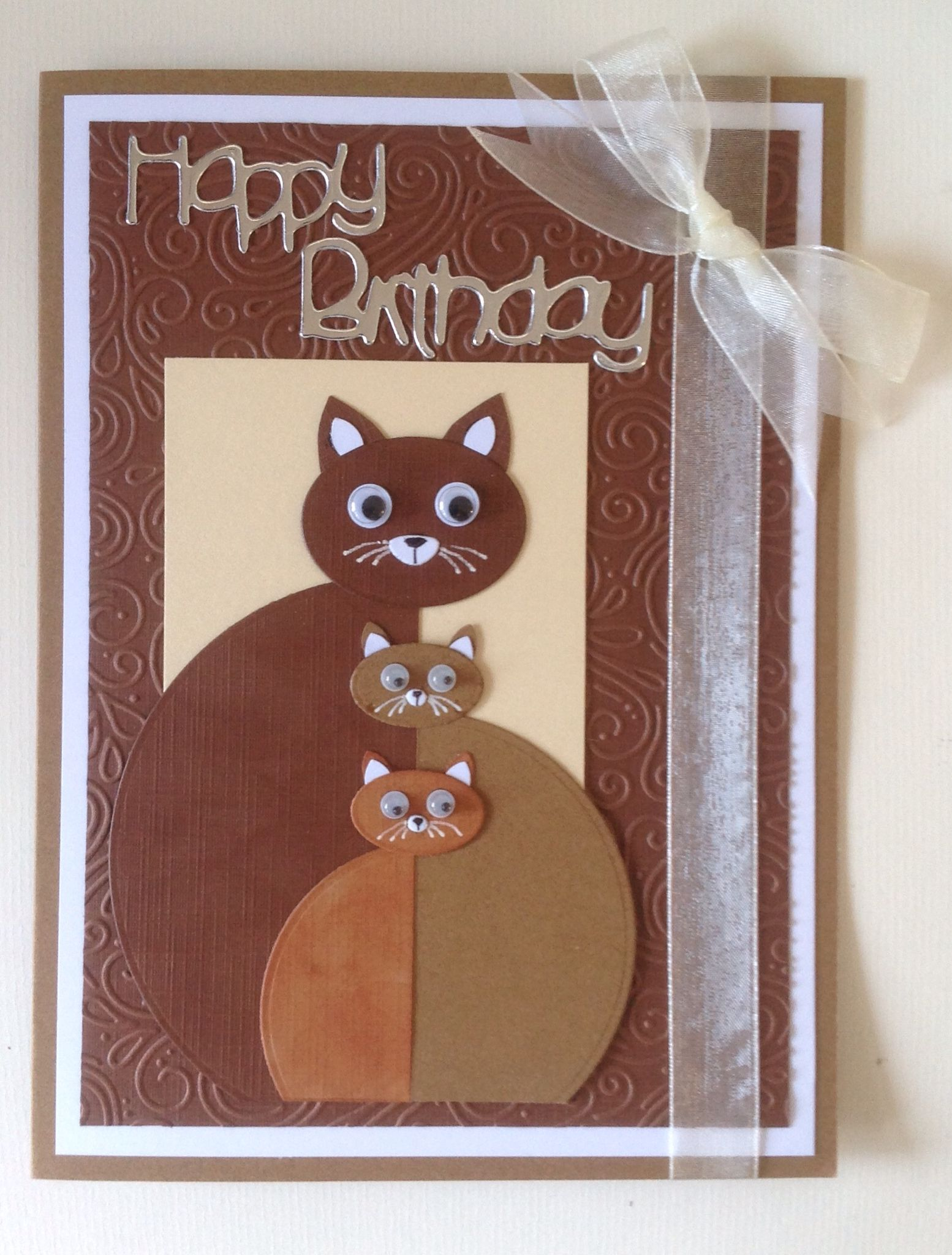 Adapted from a Michelle Zindhof design and made for my daughter who loves her cats, using circle and oval dies, white pen and googly eyes.
