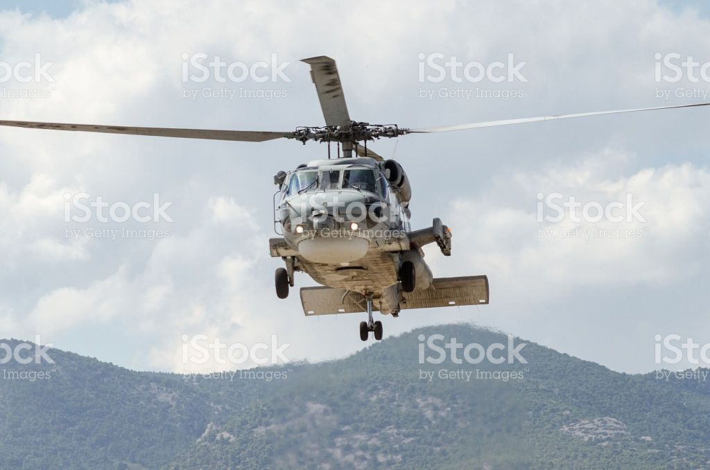 Helicopter on sky mountain back royalty-free stock photo