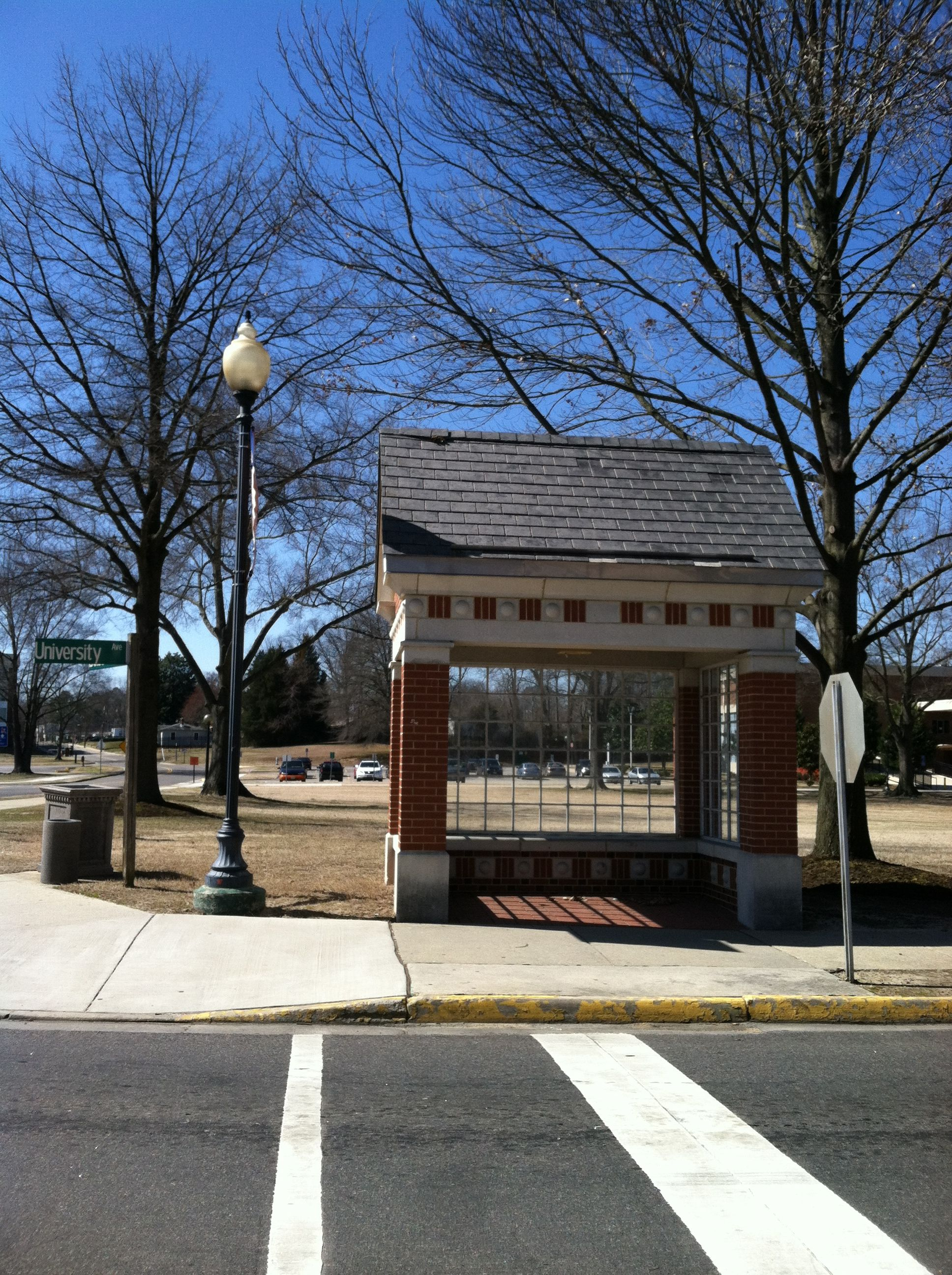 On the corner, a Bus Stop. Virginia state university