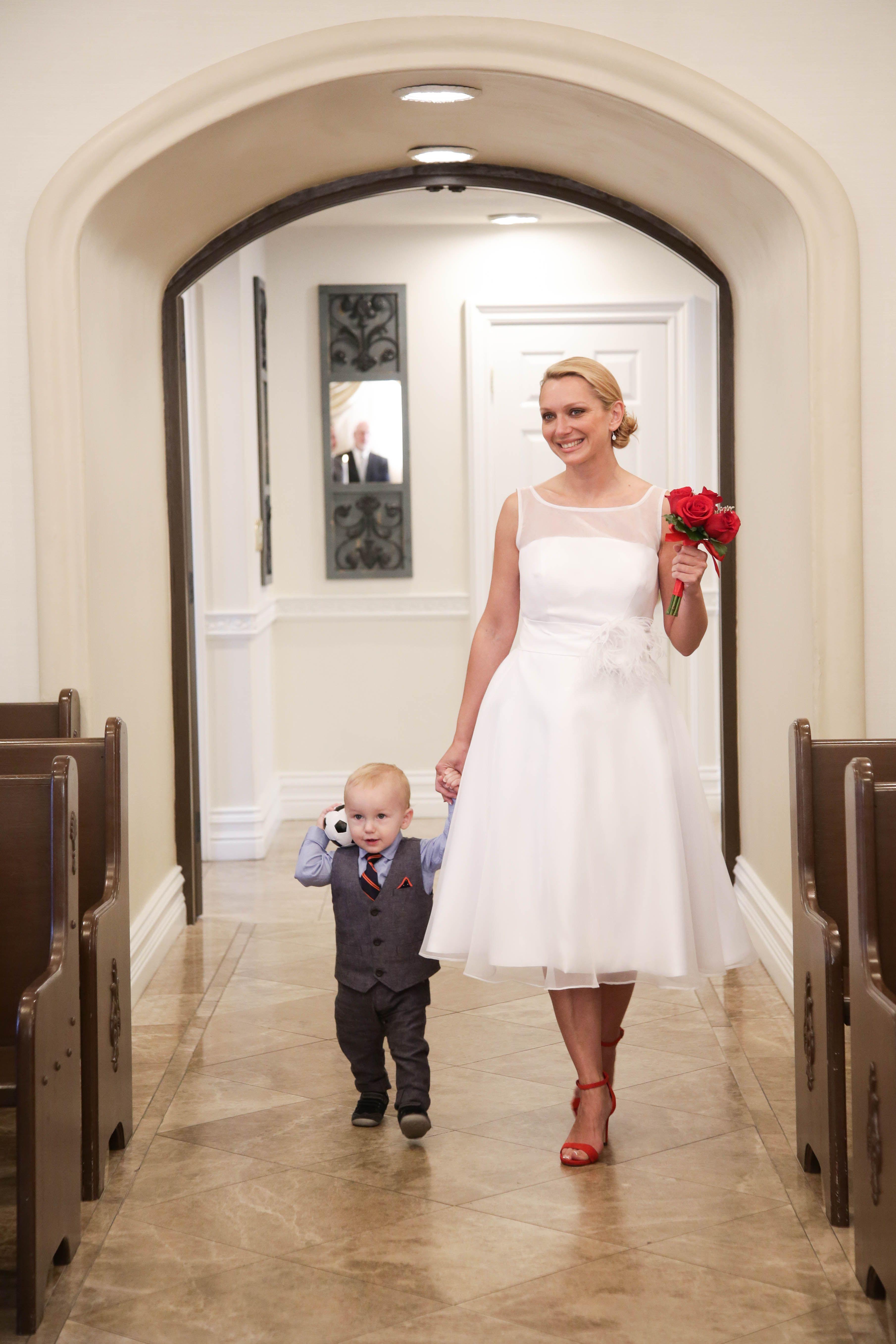 Cute ring bearer in little wedding suit. Familyfriendly