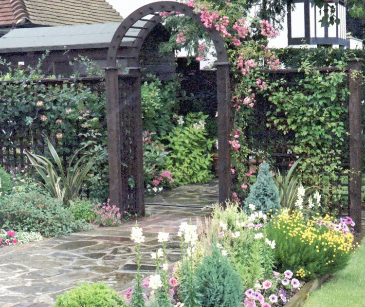 Tower Perennial Gardens: Timber Archway With Side Trelliage, Leading To A Flower