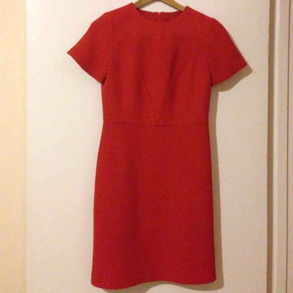 Banana Republic orange wool dress Great classic Banana Republic dress, knee length, short sleeves, great stitching on bust and skirt, zipper in back, knee length, silk lining. Orangish/red. Great for work or a formal event! Banana Republic Dresses Midi