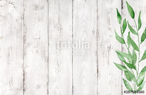 Green watercolor leaves on rustic white wood background