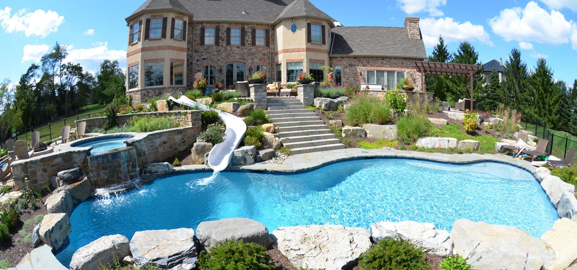 Custom pool with waterslide spa diamond brite finish for Pool exterior design