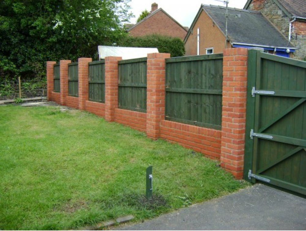 heres a backyard brick and wood privacy fence - Brick Wall Fence Designs