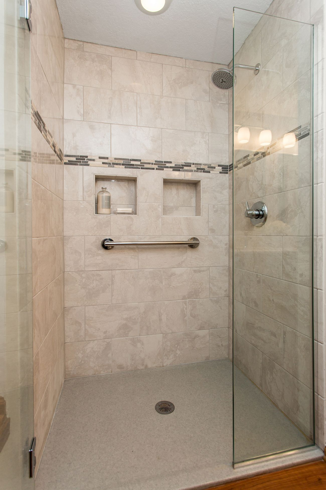 This remodeled shower blends style and accessibility with a zero