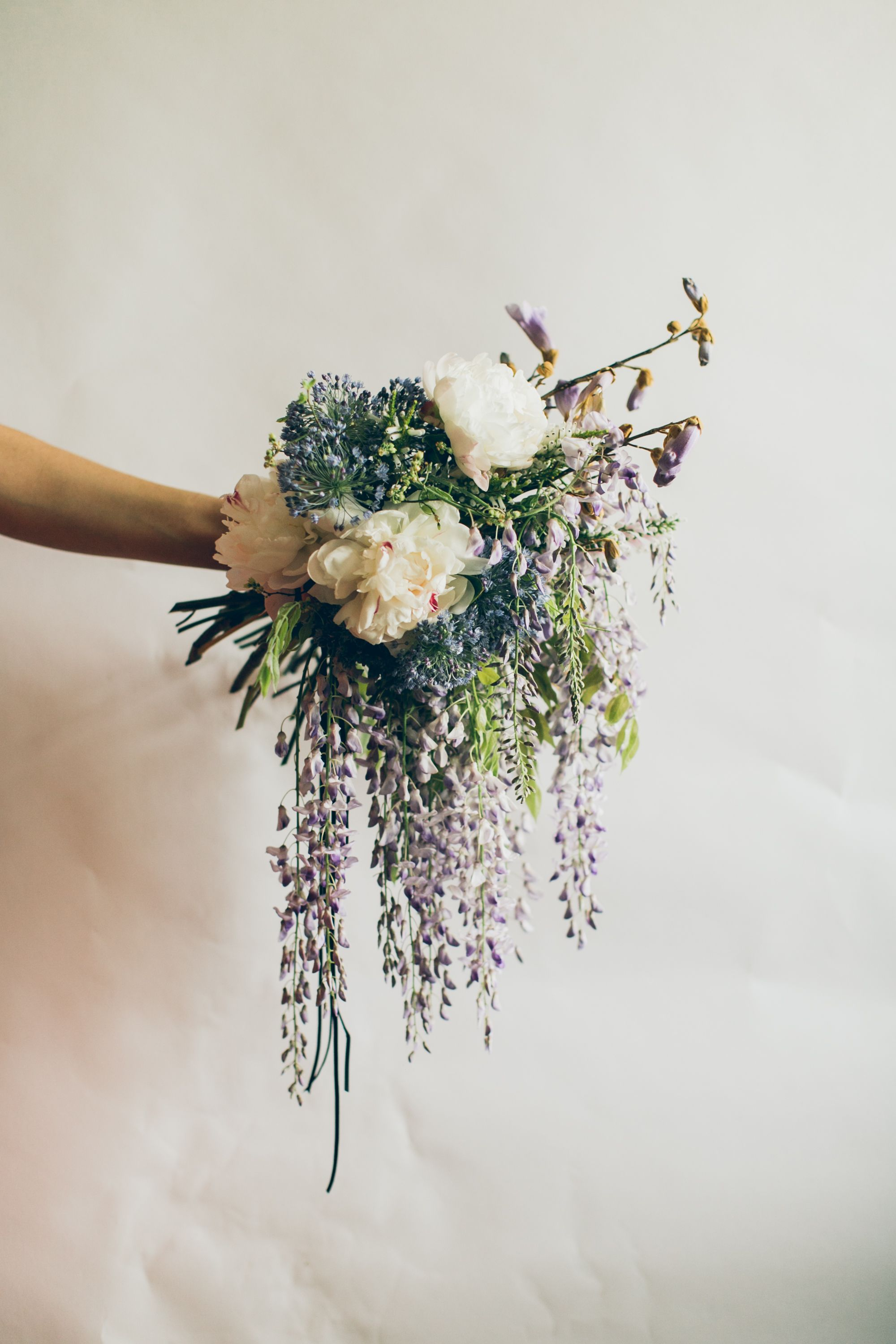 A boho bridal bouquet inspired by one of Spring/Summer 2015's biggest trends: FRINGE. (Photo: UNIQUE LAPIN Photography) (wisteria, peonies, alium, floral design, nyc florist)