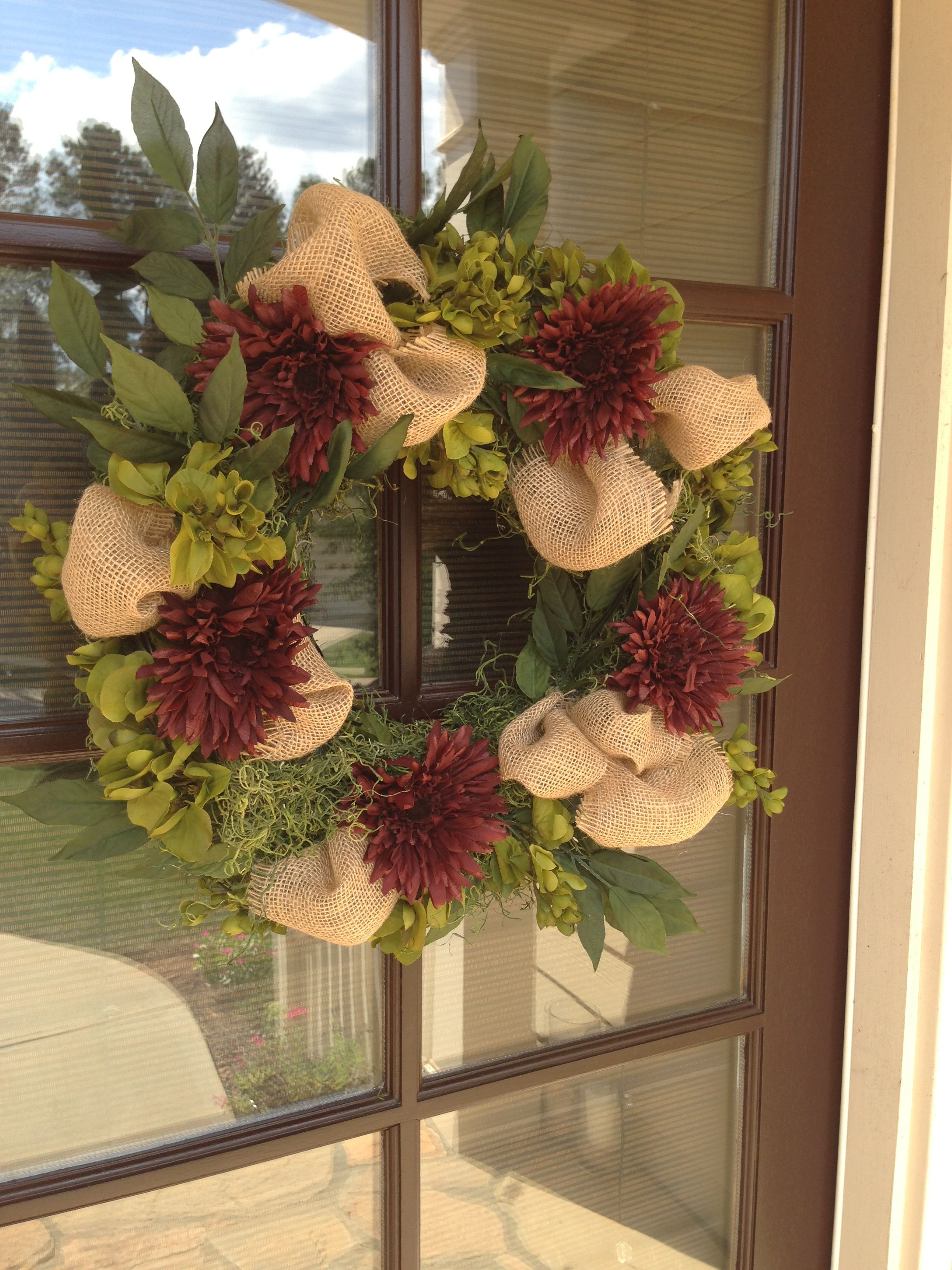 Fall wreath made with fall, silk flowers, burlap and
