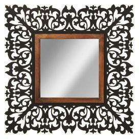 """With a scrolling openwork metal frame in black, this eye-catching wall mirror is equally at home in a country cottage or uptown brownstone.   Product: Wall mirrorConstruction Material: Metal and mirrored glassColor: Black and brownDimensions: 33.88"""" H x 33.88"""" W x 3"""" DCleaning and Care: Hand wash"""