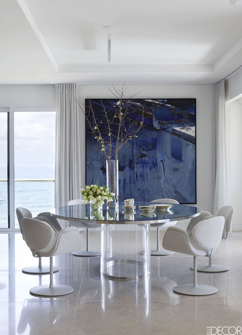 The Minimalist White Dining Area In This Palm Beach Apartment Features  Modern Pierre Paulin Swivel Chairs