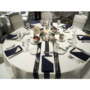 Navy Stripe Table Runner Over White Round Tablecloth.