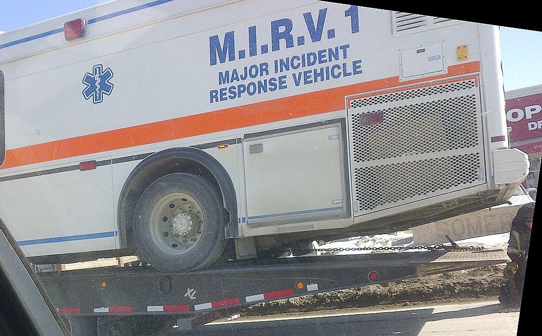 Ems ambulance gets a tow near hospital in winnipeg mb