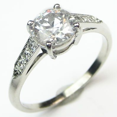 Sugar: Tempting as a sparkling chunk of rock candy, this crystalline lovely features a colorless antique cut diamond held low and smooth to the finger in a handmade basket setting. Ca. 1935. Maloys.com