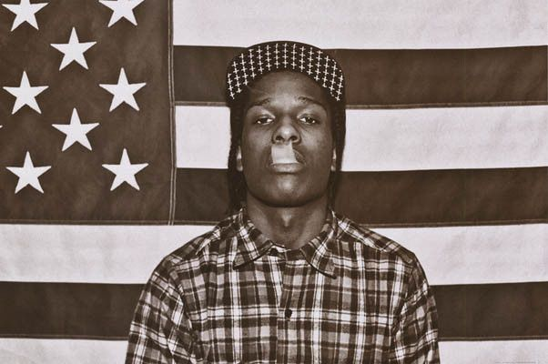 An awesome poster of rapper ASAP Rocky doing a french inhale backed by the  American Flag