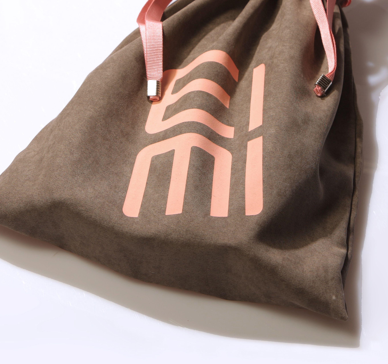 "Wella Professionals EIMI Pouch of ""velvet"" fabric."
