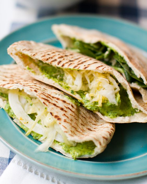 Spinach Avocado Hummus shown here in Pitas - perfect summer food.