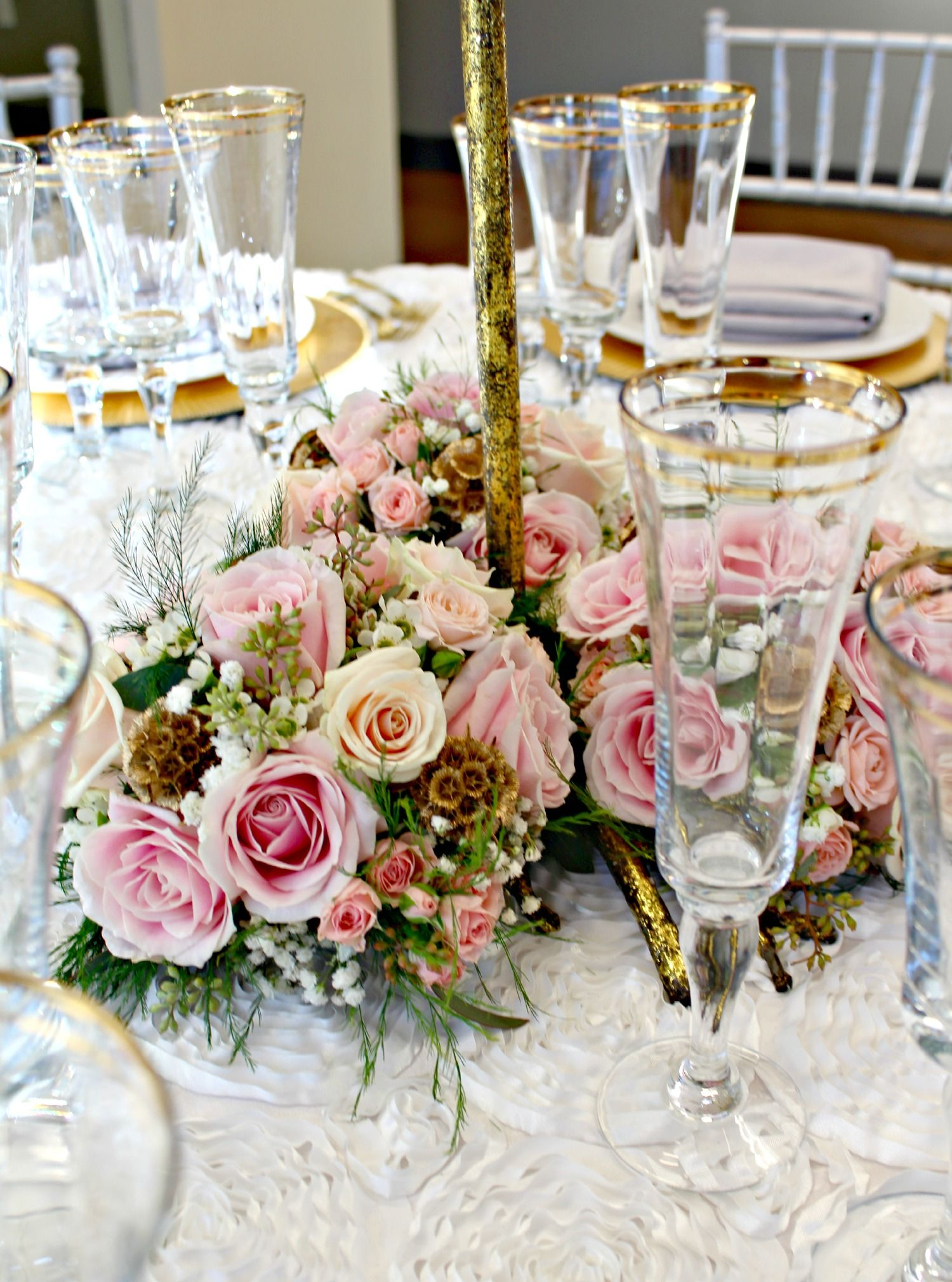 Pink, champagne and gold low and lush centerpiece. San