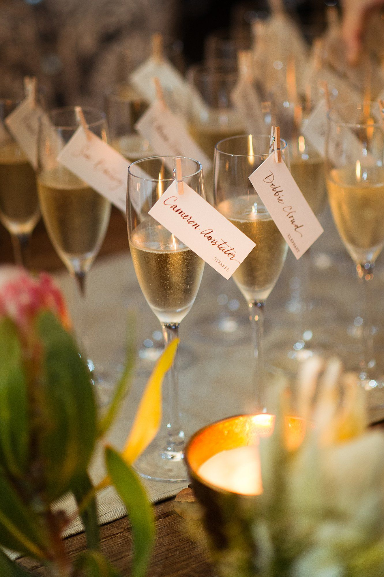 Guests grabbed yet another drink as they entered the reception. We secured place cards to champagne glasses—a win-win for both form and function.