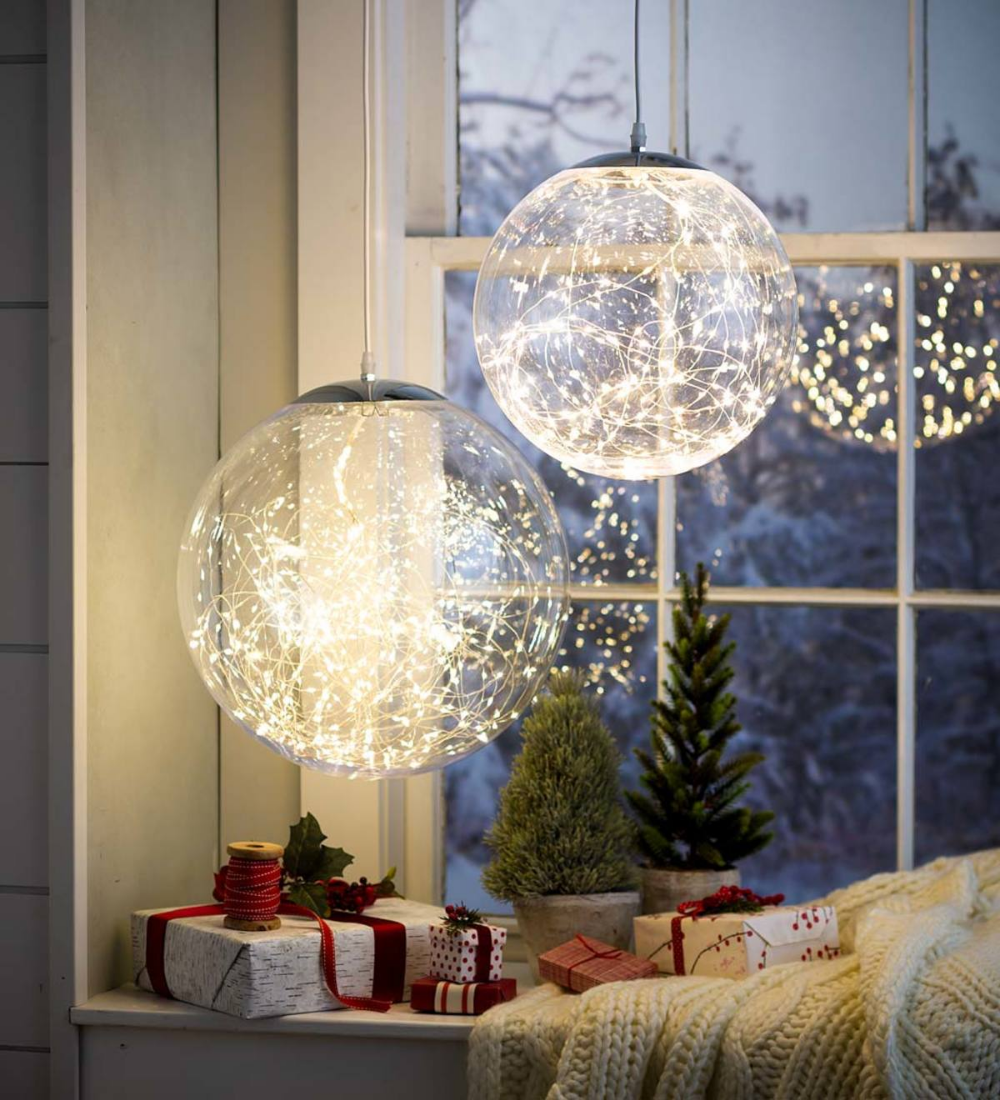 Create A Big Impact With Our Indoor Outdoor Hanging Holiday Light Ball Filled With Hundreds Of Glowing Lights Clear Ball Lights Outdoor Holiday Decor Decor