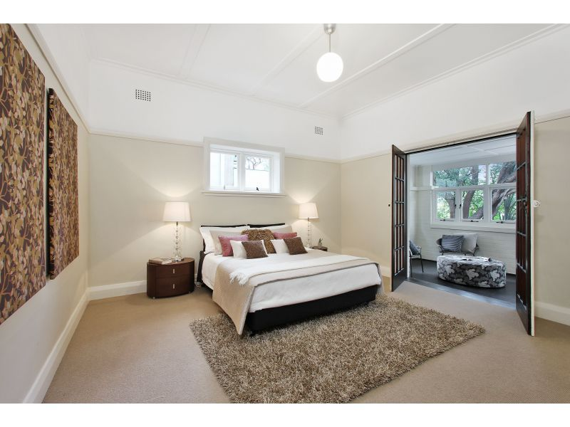 Californian bungalow with dark timber painted white i - How much is it to paint a house interior ...