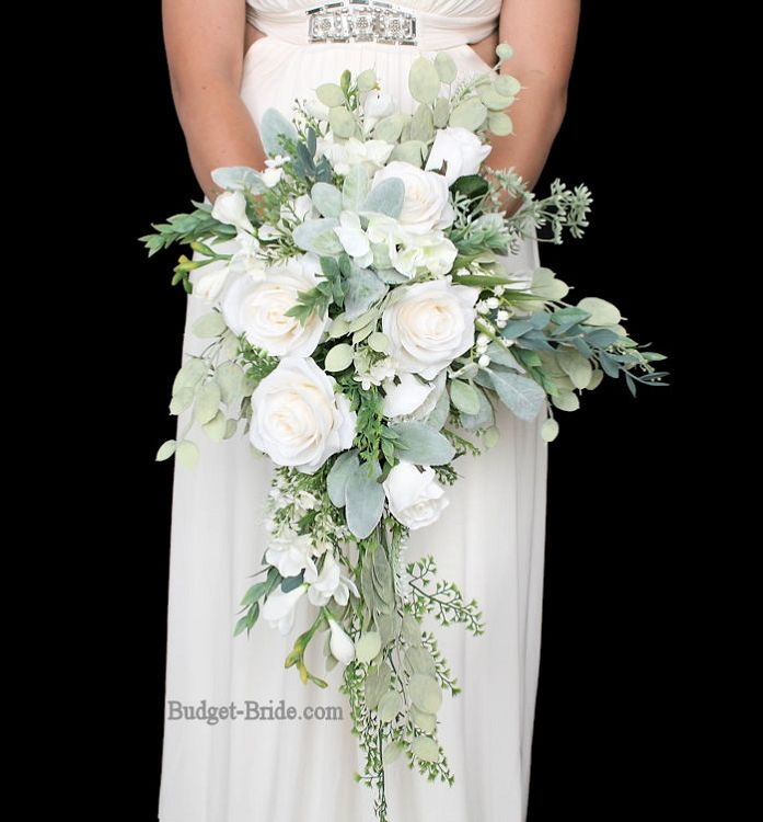 All white wedding flower bouquet with lots of greenery for White flower arrangements for weddings