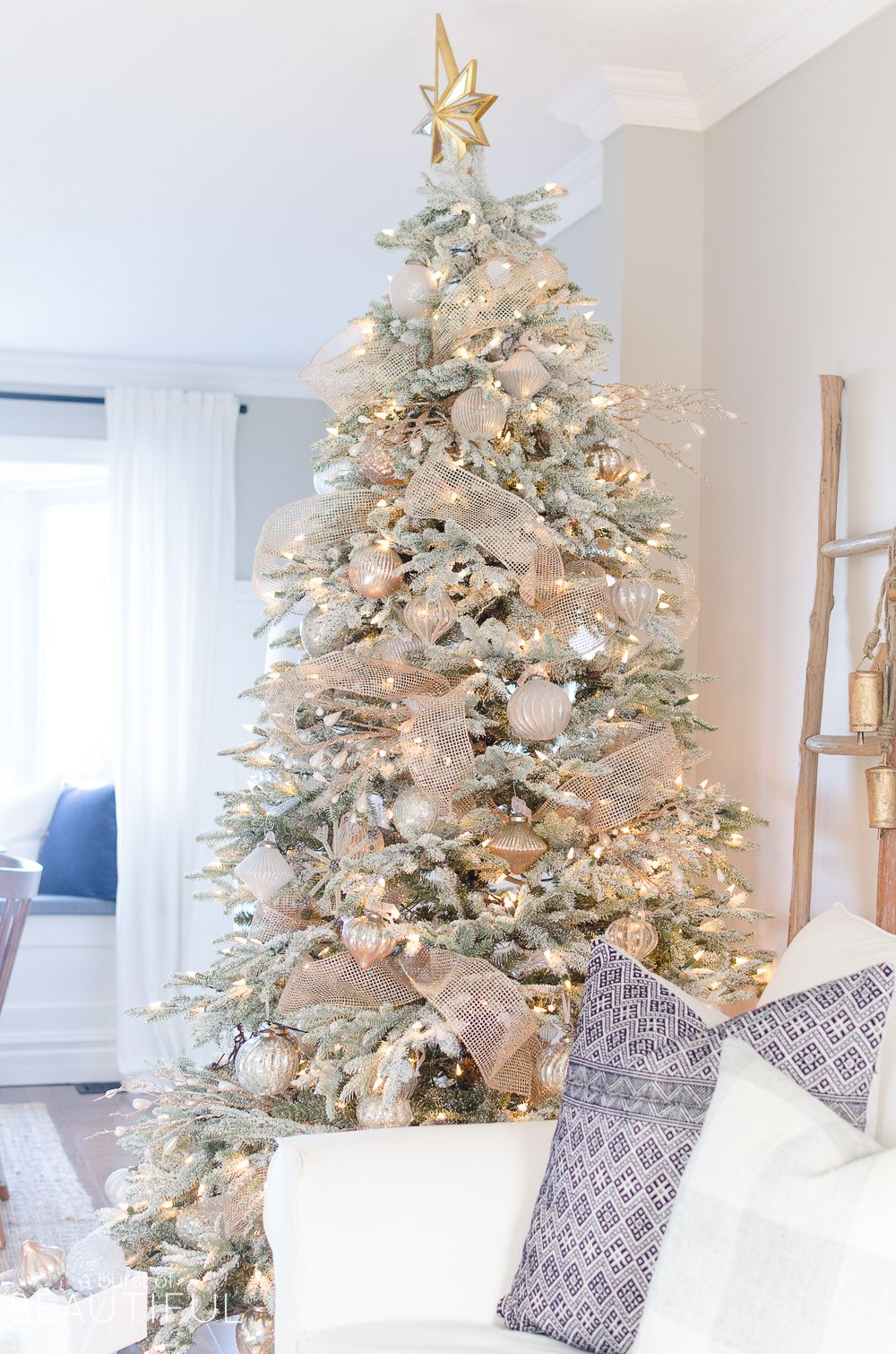 a snowy flocked christmas tree christmas decor. Black Bedroom Furniture Sets. Home Design Ideas
