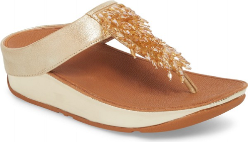 5e07e1c4b5c9 Shimmering beads adorn the T-strap of an eye-catching platform flip-flop  crafted with FitFlop s signature MICROWOBBLEBOARD midsole.