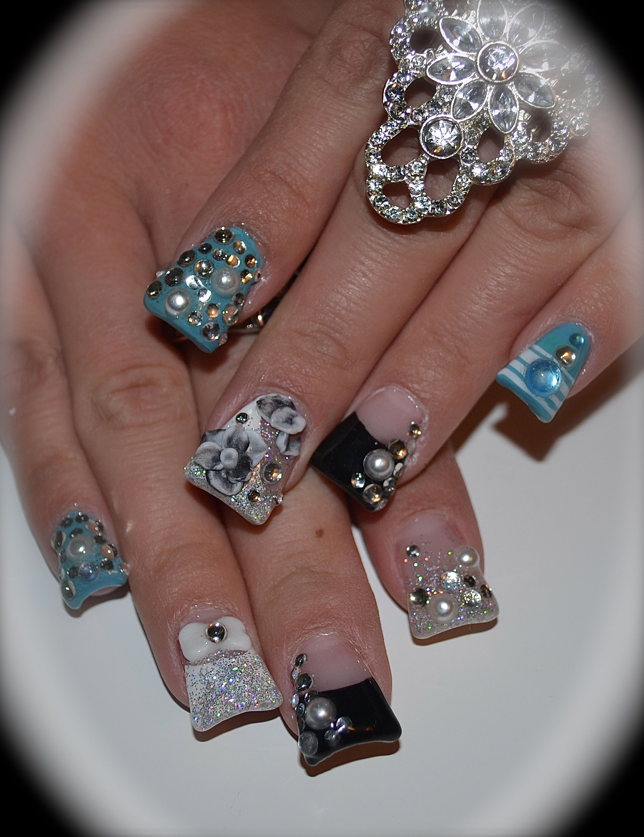 Acrylic nails with blue themed nail designs, including rhinestones ...
