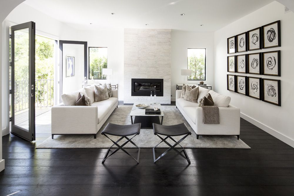 two sofas facing each other in living room white and black