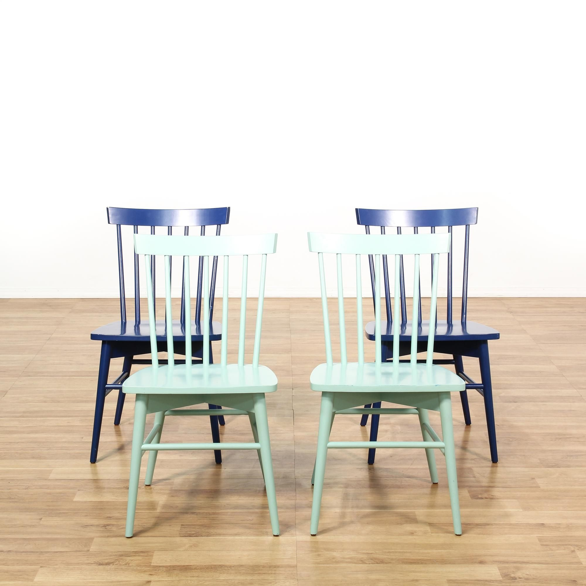 This set of spindle back dining chairs is featured in a solid wood