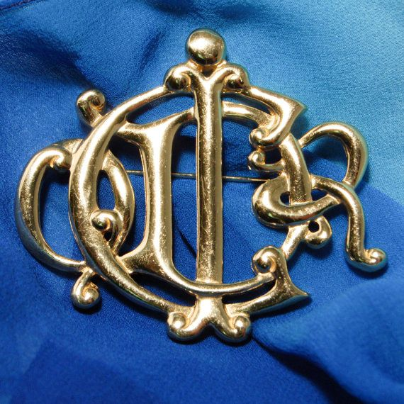 Stunning 1960s Vintage Haute Couture Christian Dior Monogram Logo Gold Tone Brooch in Gold Tone made in Germany.