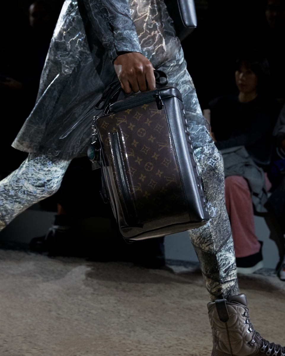 12f8357d8b6b46 A Monogram Glaze bag from the Louis Vuitton Fall-Winter 2018 Fashion Show  by Kim Jones. See all the looks now at louisvuitton.com.