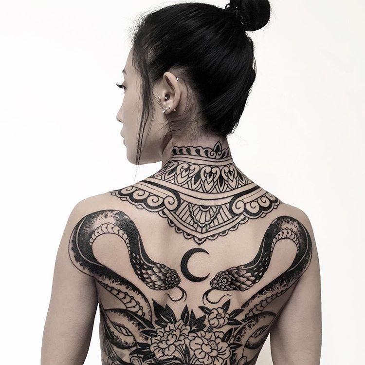 Dance with the serpent. Bodyart by @nos_tattoo from Rostov, RU. #STYNG Follow @styng.tattoo ......#snaketattoo #moontattoo #backpiece #backtattoo #ornamentaltattoo #mandalatattoo #mandalastyle #bosstattoo #geometrictattooartist #sacredgeometrytattoo #blackwork #geometricaltattoo #geometrytattoo #dotworkers #dotworktattoo #theartoftattoos | Artist: @styng.tattoo #Yakuza tattoo Geometric Inspiration | Inkstinct