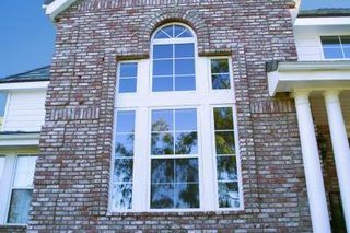 How To Replace Vinyl Siding With Brick Or Stone Ehow Vinyl Siding Exterior Brick Brick Siding