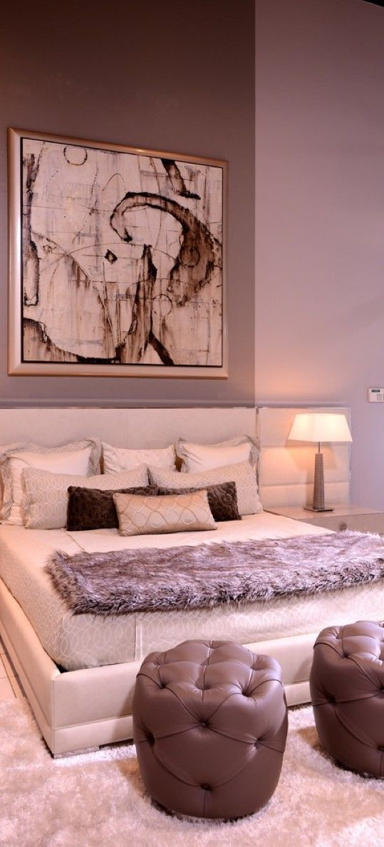 bed looks comfy, art looks expensive but not what I would choose, I ...