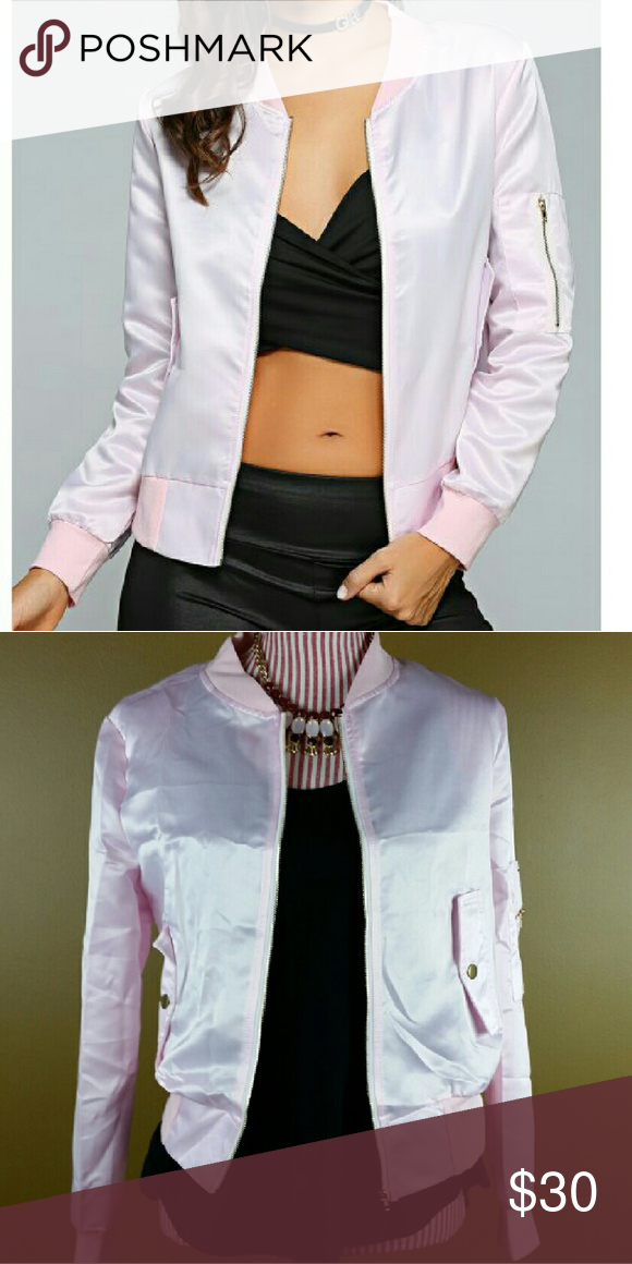 Pink Bomber Jacket Cute bomber jacket in light pink. Flap pocket details. Silver zipper detail on sleeves. Nice and lightweight for. Perfect for Fall layering. NOTE: Tag displays a size larger than the actual fit. Please see measurements below.   Small - Bust: 39.37, Length: 22.44, Sleeves: 23.23 inches   Medium - Bust: 40.94, Length: 22.83, Sleeves: 23.62 inches Jackets & Coats