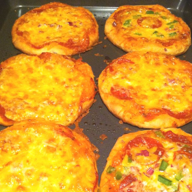 Homemade mini pizzas using Pilsbury grand refrigerated biscuits as crust. Delicious!