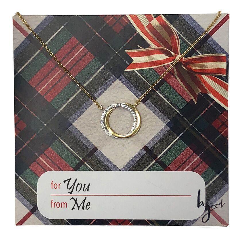Interlocking ring necklace on holiday card interlocking