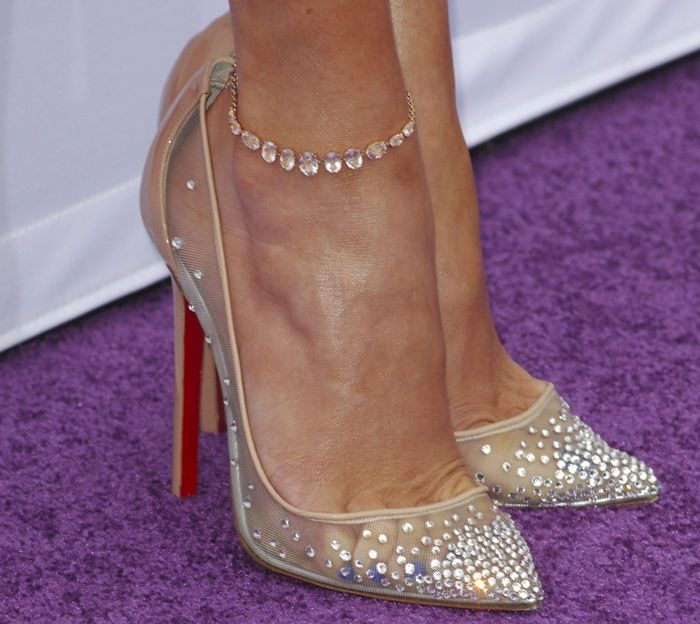 279a598d41a5 Jennifer Lopez completed the ensemble with a gorgeous pair of  crystal-embellished pumps from Christian Louboutin