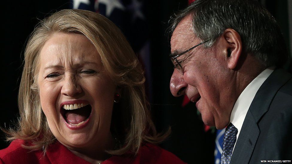 Feb 2013   Former US Secretary of State Hillary Clinton jokes with Secretary of Defence Leon Panetta after being presented with the Department of Defence's highest award for public service.