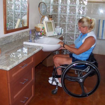 Space options project residential accessible bathroom sink with wheelchair access chair in for Wheelchair accessible sink bathroom