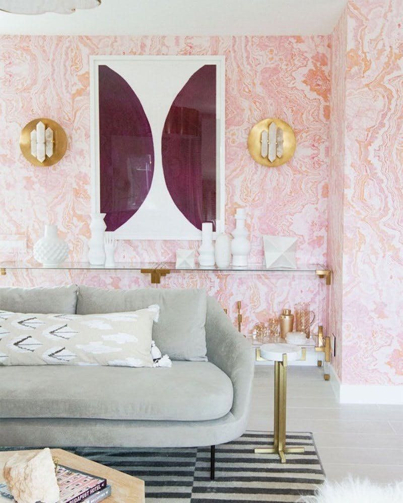 Millennial pink wallpaper with gold accents is