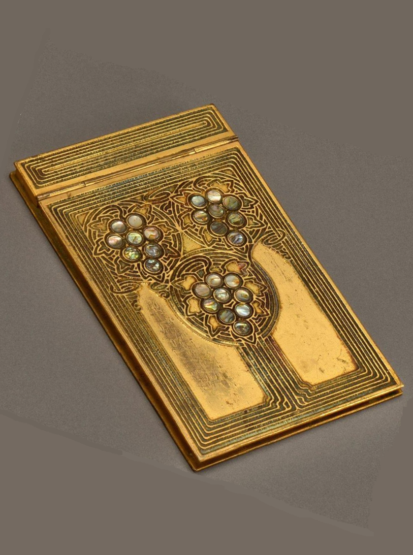 Gilded bronze notebook with an incised geometrical decoration, by TIFFANY STUDIOS NEW YORK, circa 1920. Signed Tiffany Studios New York, and numbered.