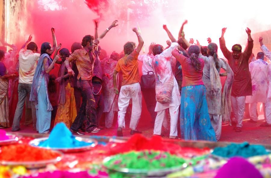 Image result for A Holi in advance with sticks and lots of color in India