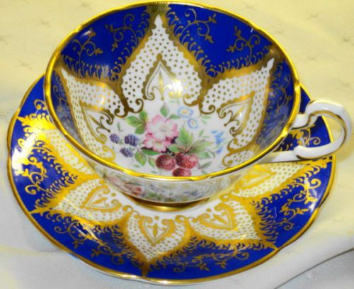 PARAGON-GOLD-FRUIT-FLOWERS-STAR-TEA-CUP-AND-SAUCER-COBALT-STRAWBERRY