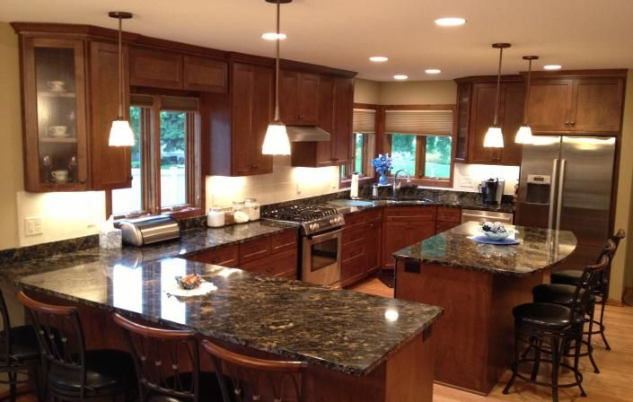 Different kitchen stations for prepping, hot foods, and ...