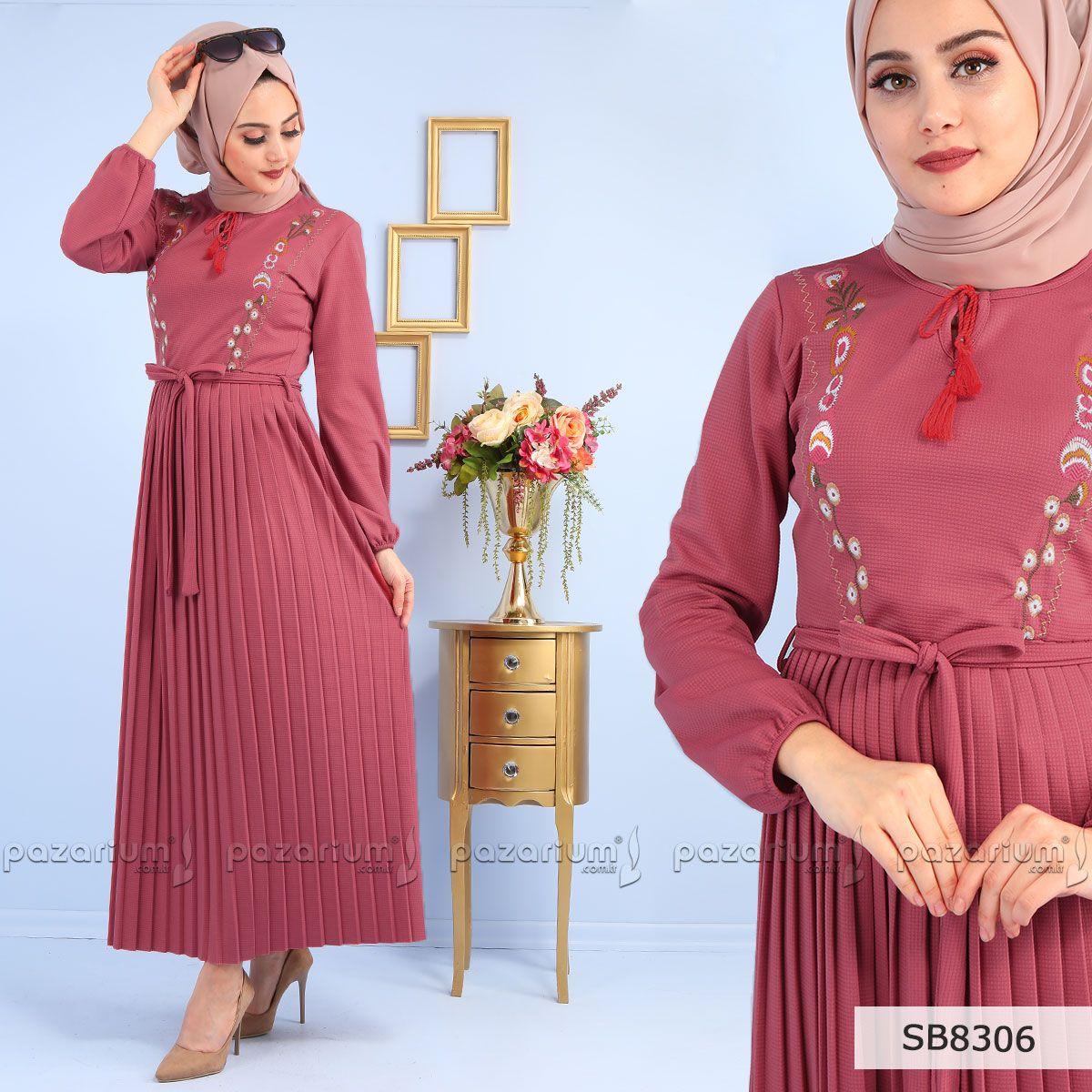 d8d28f788c020 Eteği pliseli olan taba renkli elbise boydan modeldir. Elbisenin kol uçları  lastikli olup, yakası