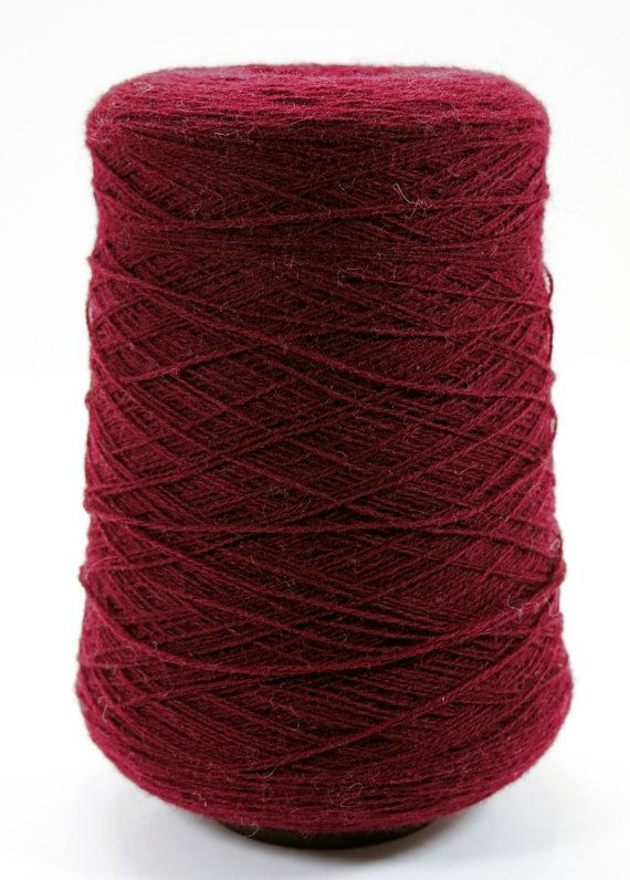 100% wool yarn in port red 26 oz. cone Glenshear. Made in Scotland Yield: 4,300 yards / lb. lace weight  Handweaving, hand and machine knitting,